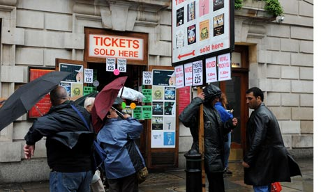 Tourists queue for theatre tickets in Covent Garden