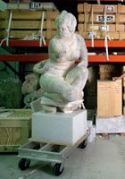 Artworks and a statue in storage