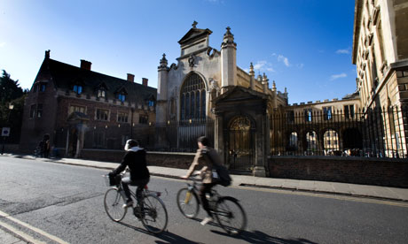 Wheel of fortune … cyclists pass Peterhouse, Cambridge University.