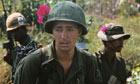 US Soldier Wearing Pink Flower on Helmet
