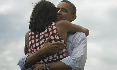 Barack Obama hugs his wife Michelle