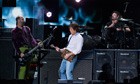 Paul McCartney (C) performs with Krist Novoselic (L) and Dave Grohl at 12.12.12 gig in New York