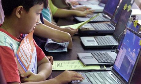 Malaysian boy on computer