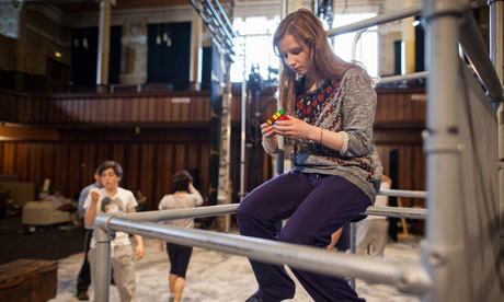 Rebecca Benson mastering the Rubik's cube