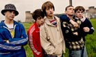 Spike Island cast members in wet-looking field