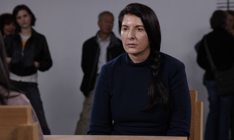 Marina Abramović performs The Artist Is Present, which provided the inspiration for Jay-Z's latest v