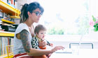Young mum working on laptop for Mumsnet story