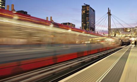 Fast moving train leaving station. Photograph: Rob Macdougall/Getty Images