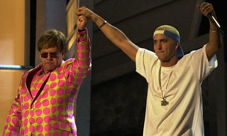 Elton John and Eminem share the stage following their duet at the 43rd annual Grammy Awards