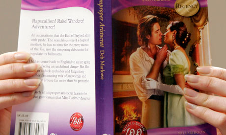A woman reads a Mills & Boon novel