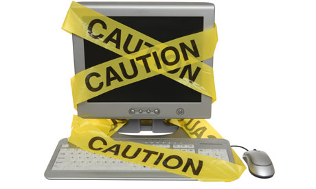 Caution tape on computer