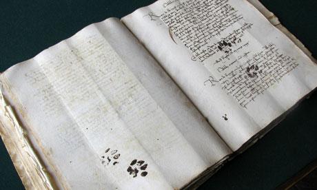 Pawprints on manuscript