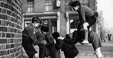 Children playing in the street, 1950