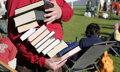 Man carrying pile of books at Hay festival 2007