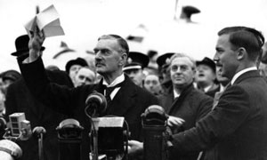 Neville Chamberlain returns from Munich
