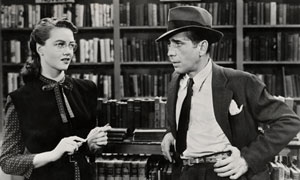 Dorothy Malone and Humphrey Bogart in The Big Sleep