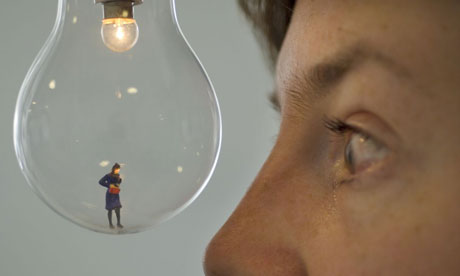 Bridget Caswell stares at her miniature self-portrait