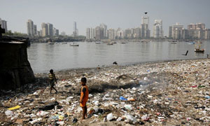 Children playing in the rubbish of a shanty town at Nariman Point, Mumbai