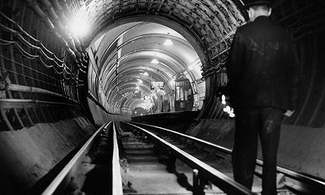 1953 - A London Underground tunnel cleaner approaching a station on foot
