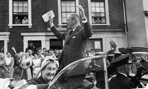 Harold Macmillan waves to supporters in London during his 1959 election campaign
