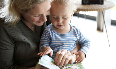 Mother and baby looking at book