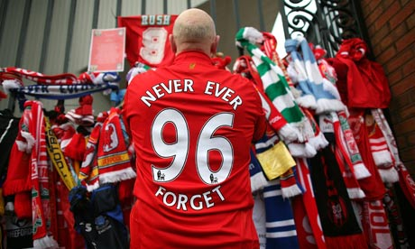 A Liverpool fan pays his respects at the Hillsborough memorial at Anfield