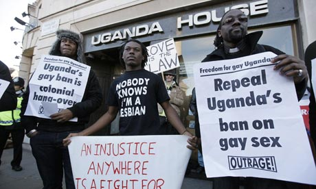 Demonstrators protest outside the Ugandan embassy in central London.