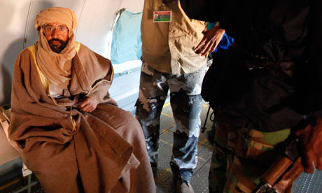 Saif al-Islam Gaddafi is pictured sitting in a plane in Zintan