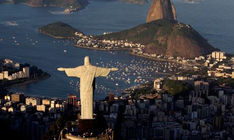 The statue of Christ looms over Rio de Janeiro.