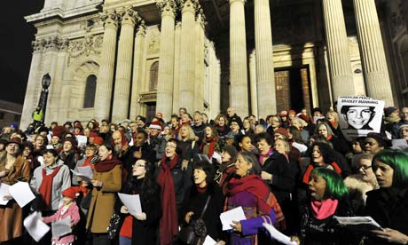Occupy London protesters and supporters sing Christmas songs on the steps of St Paul's