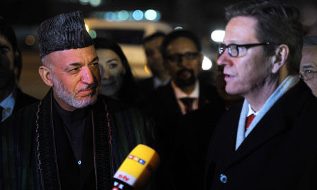 The Afghan president, Hamid Karzai, left, is met by the German foreign minister, Guido Westerwelle