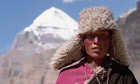 A Tibetan Pilgrim with the sacred mountain Kailas in the background
