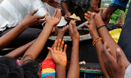 Indian villagers receive foods