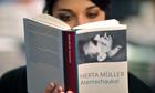 A young woman reads Herta Mueller's novel 'Atemschaukel'.