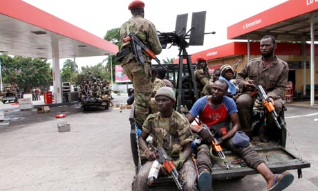FRCI soldiers, Ivory Coast at a petrol station