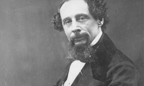 Charles Dickens with a big wispy beard and two tufts of hair around a huge bald head
