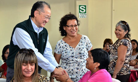 Jim Yong Kim, the new World Bank president, greets women at a cultural centre in Lima, Peru
