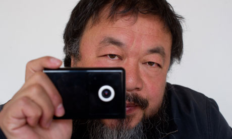 Artist Ai Weiwei holds a webcam he was reportedly ordered by Chinese police to disconnect