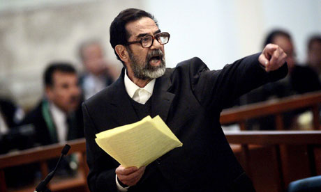 Saddam Hussein, on trial for crimes against humanity, argues with prosecutors in Baghdad, 2006