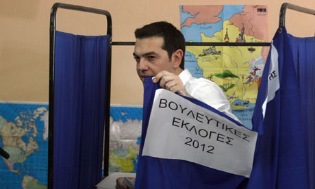 Syriza's leader, Alexis Tsipras, casts his vote in Athens on Sunday