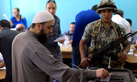 A man casts his vote on Saturday at a polling station 60km north-east of Cairo