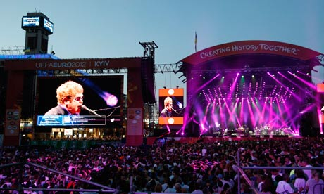 Elton John performs at a charity concert dedicated to the fight against HIV/Aids in Kiev
