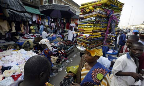 A woman sells material in a market in Ivory Coast's commercial capital, Abidjan