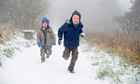 Children run through the snow at Sutton Bank near Thisk