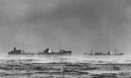 A convoy of ships passes through Arctic fog in 1945
