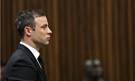 Oscar Pistorius stands during sentencinfg