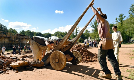 Workers carry stones on the construction site