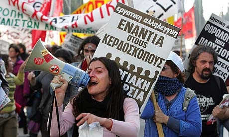 Protesters shout slogans during a demonstration in central Athens
