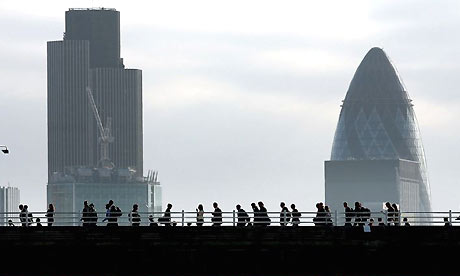 Commuters cross Waterloo Bridge to the City of London
