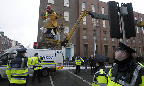 Protestor on a crane near the Irish Dail, 7 December 2010